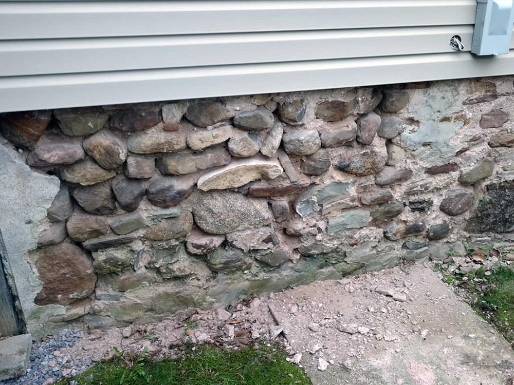 Before Stone Foundation and Structural Repair