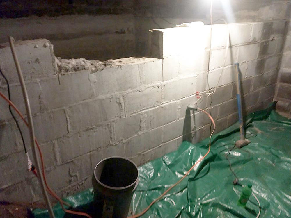 Start of removal of Basement Cistern Wall