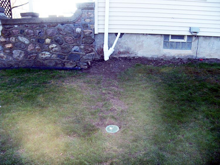 Lawn Scape Bubbler Pot Installed on Underground Gutters Discharge Line and Sump Pump Drainage Line